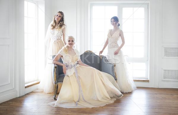 Young women near window wearing wedding dresses Stock photo © dashapetrenko