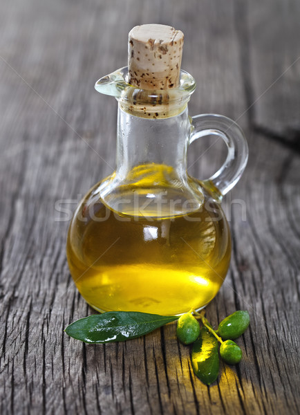 Olive oil and olive branch  Stock photo © dashapetrenko