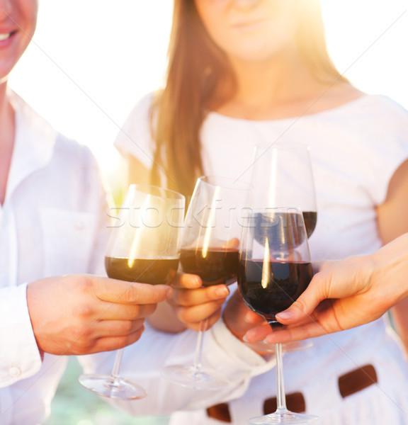 Personas gafas vino tinto brindis Foto stock © dashapetrenko