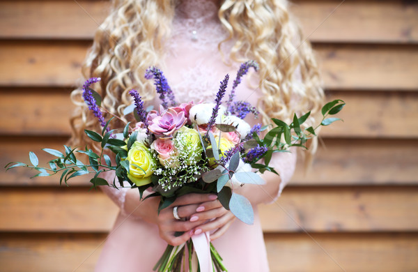 Bride holding the wedding bouquet with succulent flowers Stock photo © dashapetrenko