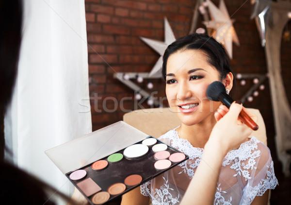 Make-up artist doing make up for bride  Stock photo © dashapetrenko