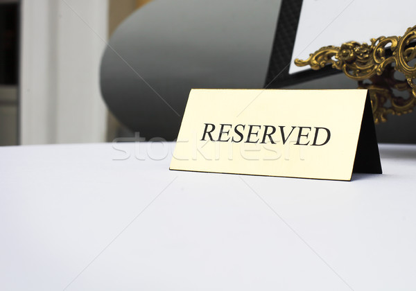 Reserved sign on the table in restaurant Stock photo © dashapetrenko