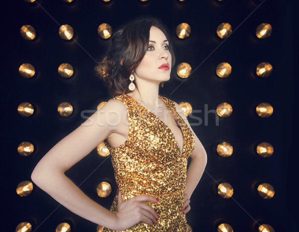 Superstar vrouw gouden jurk Stockfoto © dashapetrenko
