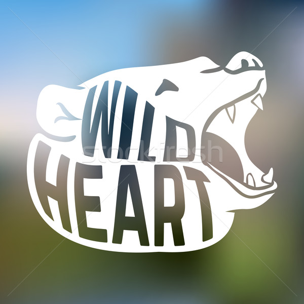 Bear head silhouette with concept wild text on blur background Stock photo © Dashikka