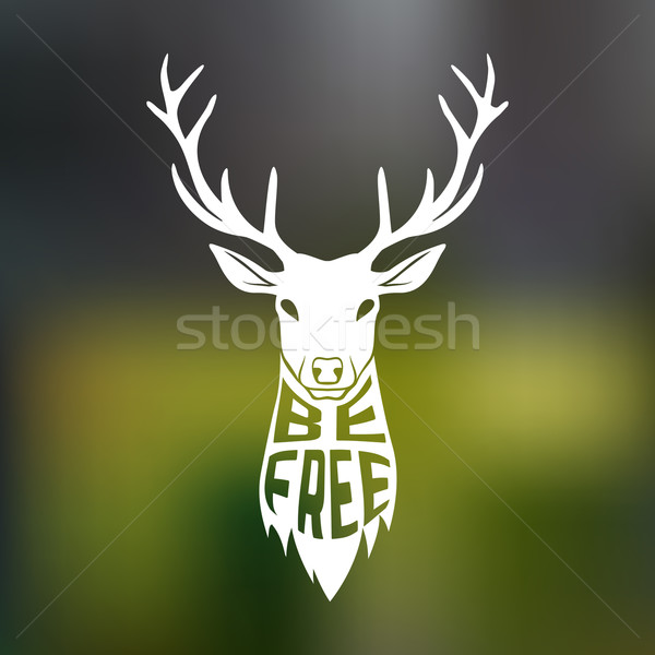 Concept silhouette of deer head with text inside be free on blur background. Stock photo © Dashikka