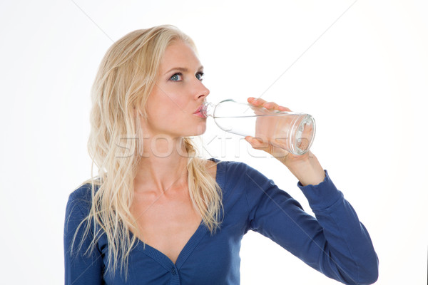 Stock photo: profile of blonde girl with bottle