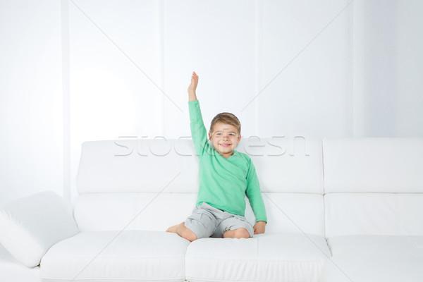 Yalıtılmış genç çocuk beyaz kanepe küçük Stok fotoğraf © Dave_pot