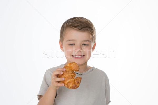 Junge Croissant Kind Aussehen verlockend gebacken Stock foto © Dave_pot