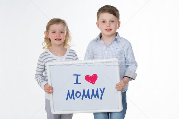 Szczęśliwy dzieci masażu mama dwa Zdjęcia stock © Dave_pot