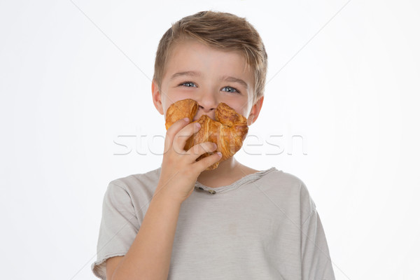 Grapje kind kid glimlacht tonen croissant Stockfoto © Dave_pot