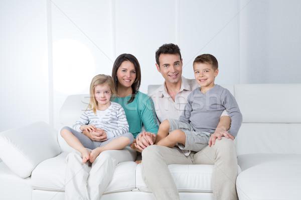 Genç aile beyaz ebeveyn çocuk oturmak Stok fotoğraf © Dave_pot