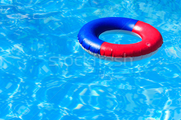 A colorful inflatable ring floating in a swimming pool Stock photo © david010167
