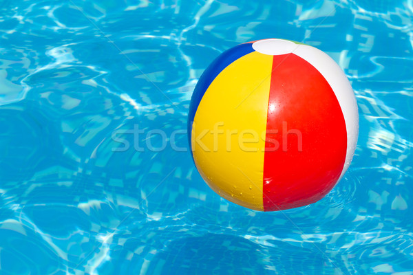 A colorful beach ball floating in a swimming pool Stock photo © david010167
