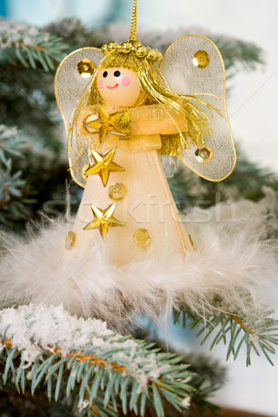 Christmas Angel on a snow encrusted tree Stock photo © david010167