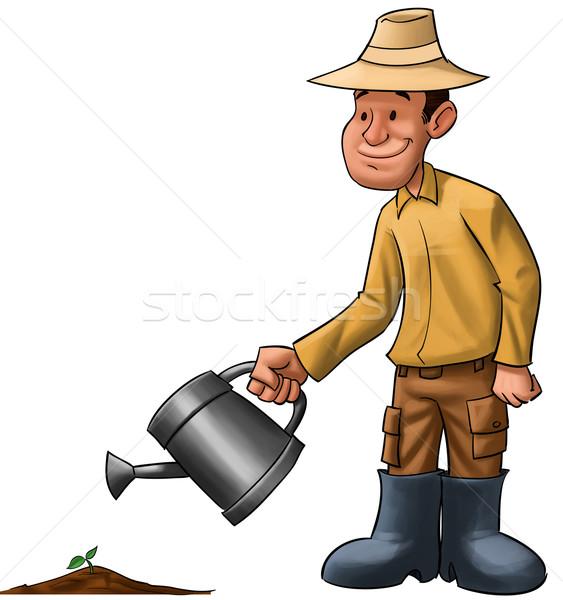 farmer sprinkle a plant Stock photo © davisales