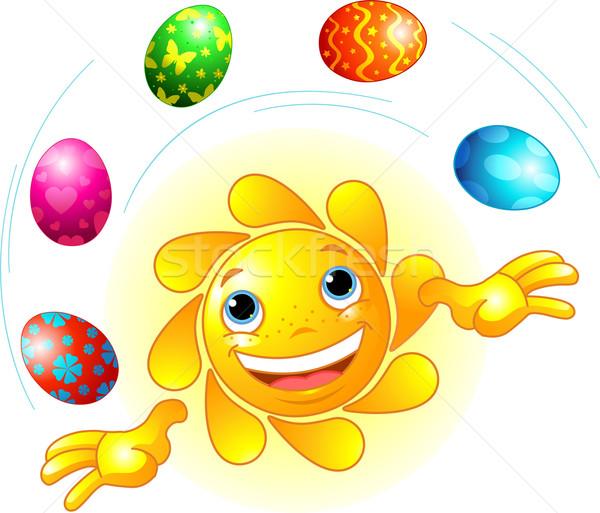 Bonitinho páscoa sol malabarismo ovos de páscoa Foto stock © Dazdraperma