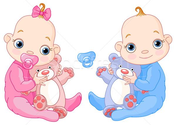 Cute twins with toys Stock photo © Dazdraperma