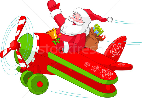 Santa Flying His Christmas Plane Stock photo © Dazdraperma