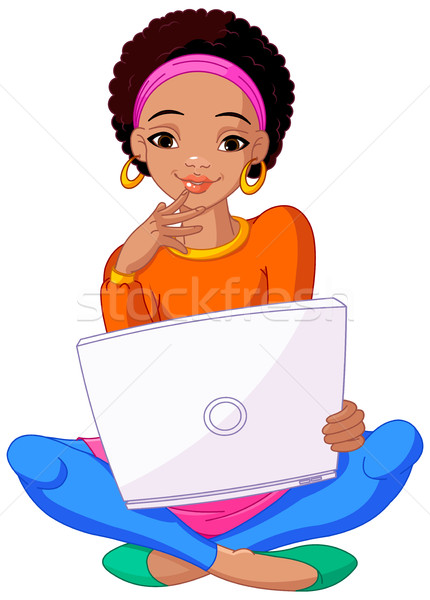 Young African Woman Sitting On Cushion with Laptop Stock photo © Dazdraperma