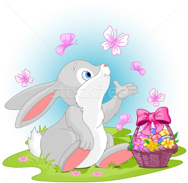 Conejo de Pascua cute sesión huevos de Pascua cesta flores Foto stock © Dazdraperma