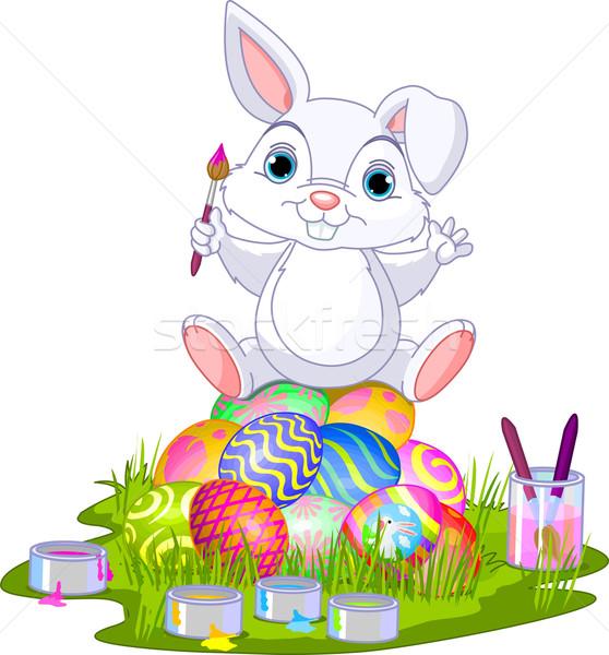 Easter. Bunny sitting on eggs  Stock photo © Dazdraperma