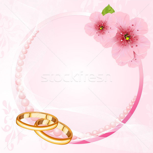 Wedding rings and cherry blossom design  Stock photo © Dazdraperma