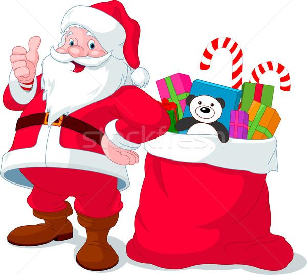 Santa Claus with sack full of gifts Stock photo © Dazdraperma