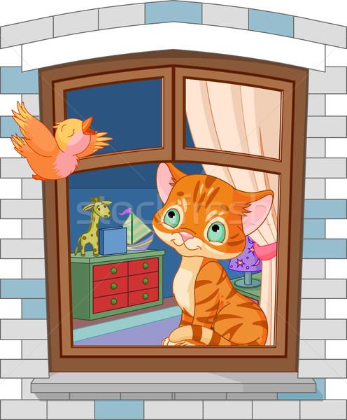 Cute kitten vergadering venster naar vogel Stockfoto © Dazdraperma