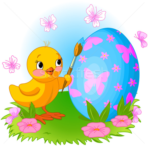 Chicken is painting Easter egg Stock photo © Dazdraperma