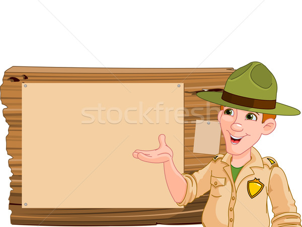 Ranger pointing at a wooden sign Stock photo © Dazdraperma
