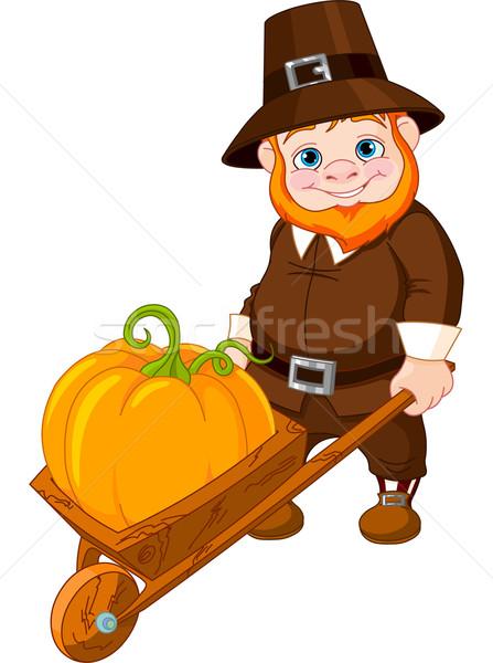 Cute pilgrim with wheelbarrow Stock photo © Dazdraperma