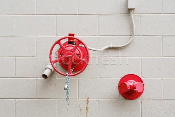 красный клапан белый стены огня Сток-фото © dbvirago