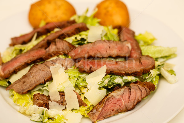 Caesar Salad with Beef Strips and Rolls Stock photo © dbvirago