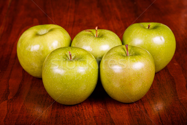 Stock photo: Five Granny Smith Apples on Table