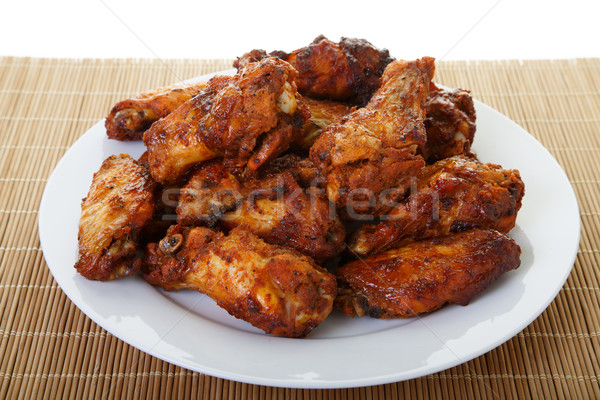 Chicken Wings on Bamboo Mat Stock photo © dbvirago
