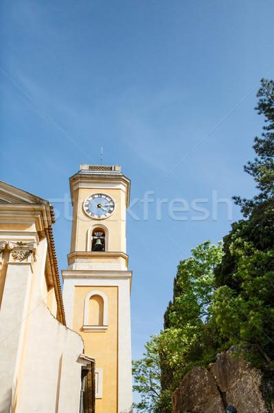 Giallo clock torre stucco cielo blu Foto d'archivio © dbvirago