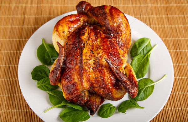 Roast Chicken on Plate Garnished with Spinach Leaves Stock photo © dbvirago