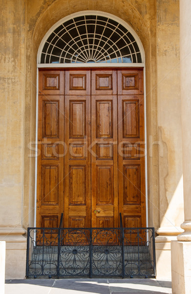 Old Carved Wood Door in Stucco Building Stock photo © dbvirago