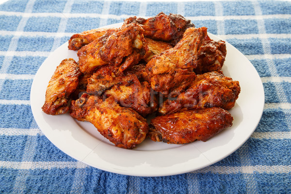 Mesquite Wings on Blue Placemat Stock photo © dbvirago