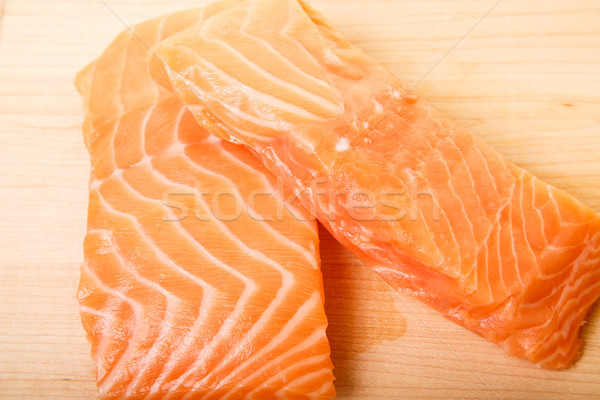 Two Atlantic Salmon Fillets on a Wood Cutting Board Stock photo © dbvirago