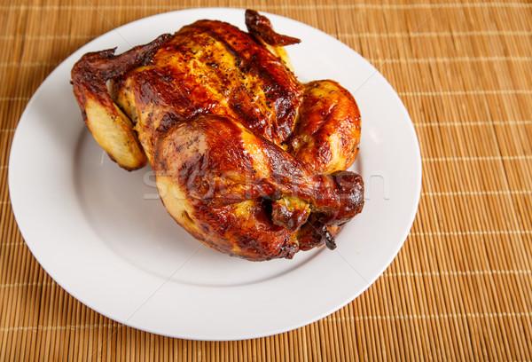 Pollo arrosto angolo di bianco piatto tutto bambù Foto d'archivio © dbvirago