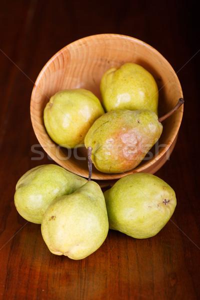Pere ciotola legno tavolo in legno alimentare frutta Foto d'archivio © dbvirago