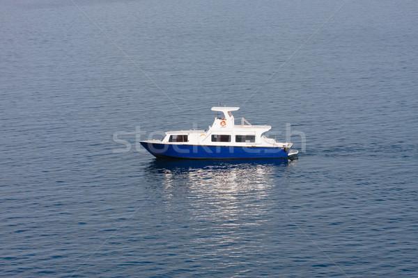 Piccolo blu bianco barca acqua Foto d'archivio © dbvirago