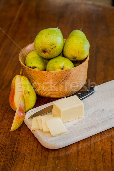 Bowl of Pears with Sliced Cheese and One Cut Pear Stock photo © dbvirago