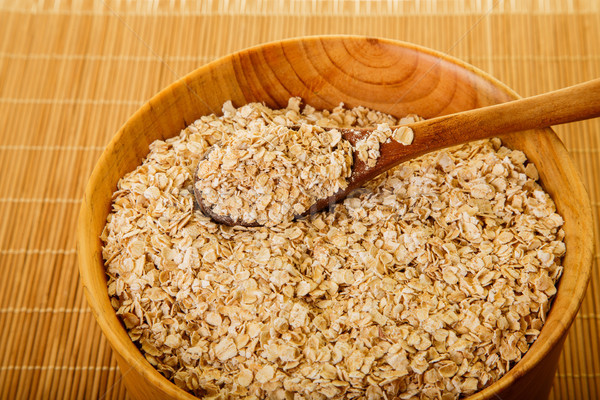 Bowl of Dried Oats in Wood Bowl Stock photo © dbvirago