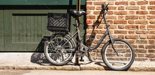 Nero bike muro di mattoni verniciato plastica Foto d'archivio © dbvirago