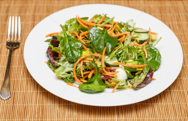 Spinach and Greens Salad with Dressing and Fork Stock photo © dbvirago