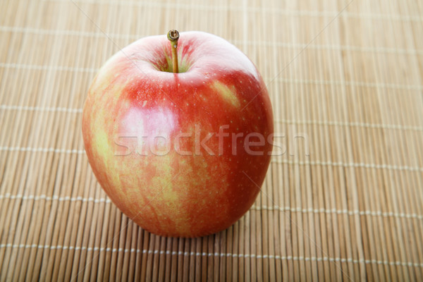 Gala Apple on Bamboo Mat Stock photo © dbvirago