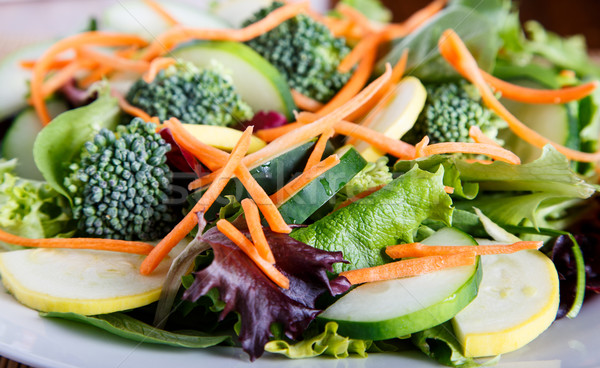 Fresh Vegetables on Mixed Green Salad Stock photo © dbvirago