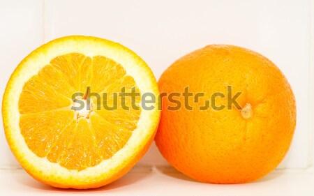 Arancione taglio metà bianco shelf fresche Foto d'archivio © dbvirago